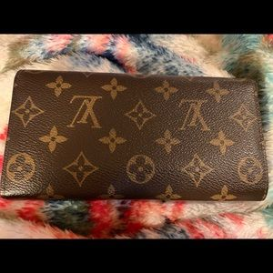 LV Sarah Wallet In excellent condition